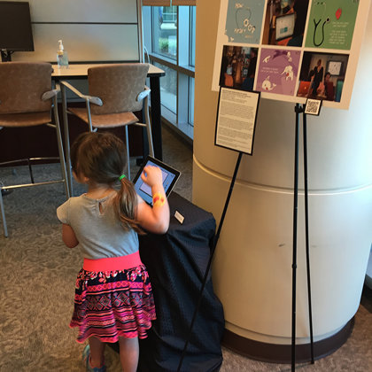 Children playing with the eBook during an artshow at Shands Children's Hospital.